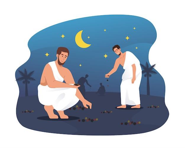 Hajj-pilger sammeln kieselsteine in muzdalifah. ritual der hajj-pilgerfahrt