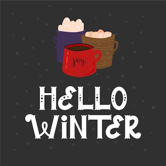 Hallo winter schriftzug mit heißer schokolade