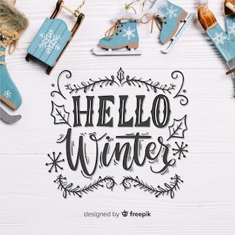 Hallo winterbeschriftung mit erschütterungen auf hölzernem brett