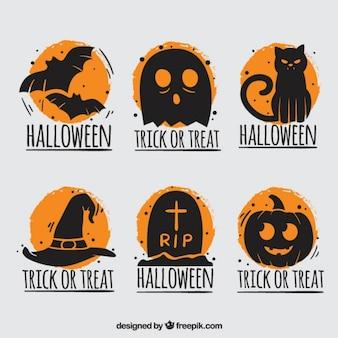 Halloween-abzeichen mit orangefarbenen hintergrund