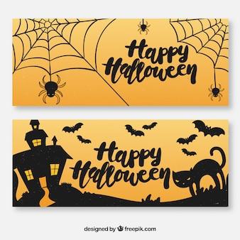 Halloween banner mit spinnweben und katze