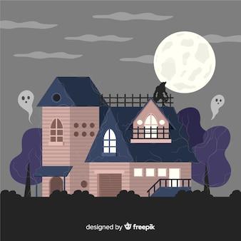 Halloween-frequentierter haushintergrund im flachen design
