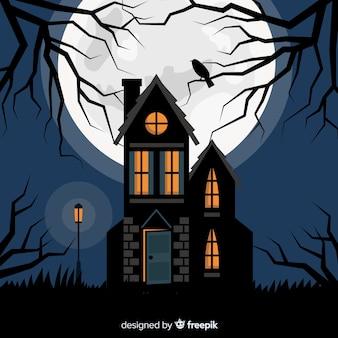 Halloween-geisterhaus mit flachem design