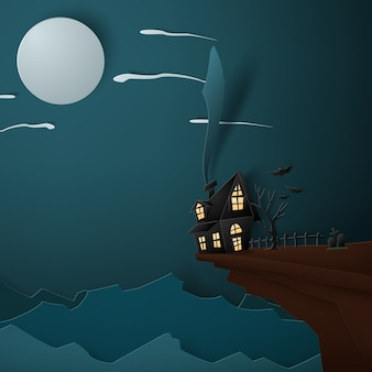 Halloween-haus auf mondhintergrundpapier-kunstkonzept.