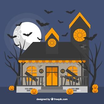 Halloween-hintergrund mit spuk haus und fledermäuse