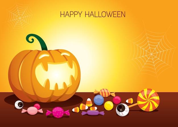 Halloween-kürbis-laterne, die hell mit süßigkeiten auf dem boden glänzt