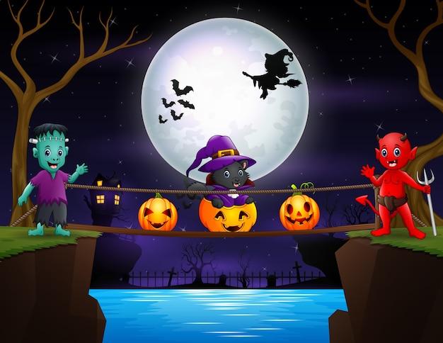 Halloween-nachthintergrund mit rotem teufel und frankenstein