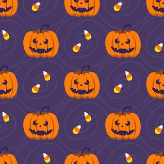 Halloween-nahtloses muster. süße kürbisse und süßigkeiten. vektor-illustration