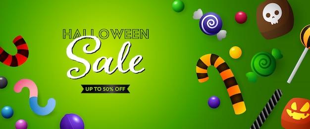 Halloween sale banner mit süßigkeiten