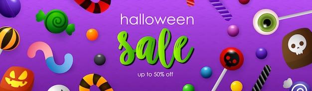 Halloween sale schriftzug mit lutscher und süßigkeiten