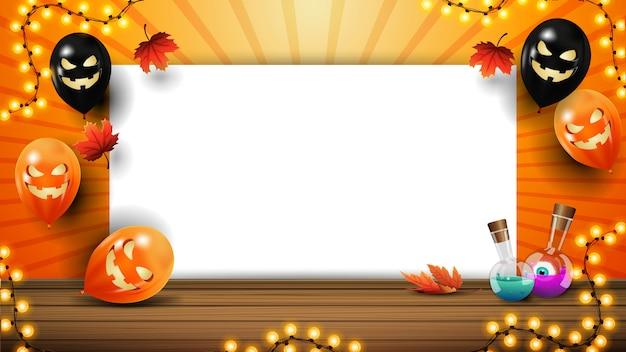 Halloween-schablone für ihre künste mit kopienraum, halloween-ballonen und girlande. orange vorlage für text mit einem blatt papier