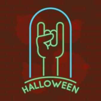 Halloween-schriftzug im neonlicht mit hadn-rock'n'roll-symbol