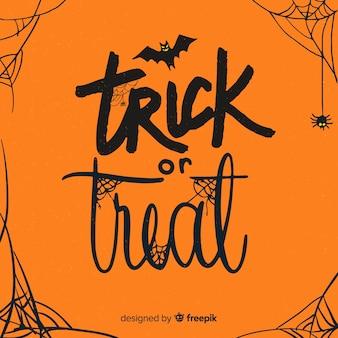 Halloween-schriftzug in orangetönen mit spinnweben