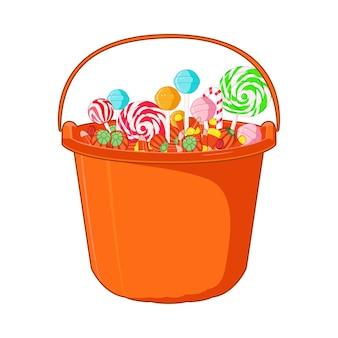 Halloween süßigkeiten und bonbons auf dem eimer