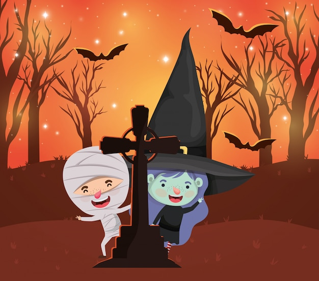 Halloween-szene mit den kindern kostümiert auf dem kirchhof