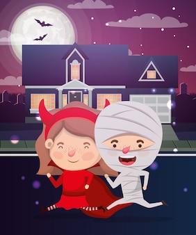 Halloween-szene mit den kindern kostümiert in der nachbarschaft