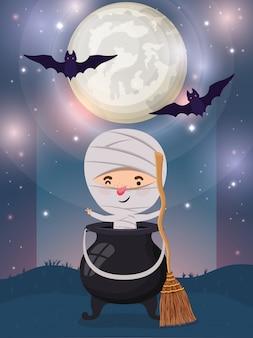 Halloween-szene mit jungenkostümmama