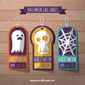 Halloween verkauf etiketten in flachen stil