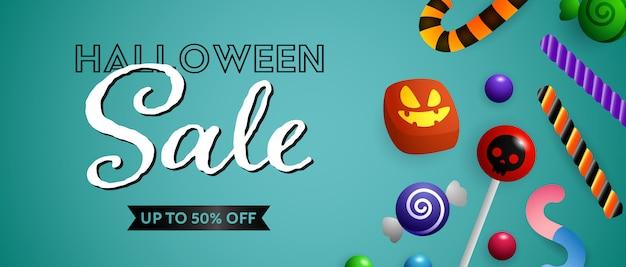 Halloween-verkaufsbeschriftung mit netten süßigkeiten und bonbons