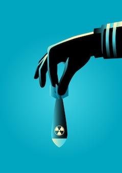 Hand bereit, eine atom- oder atombombe fallenzulassen