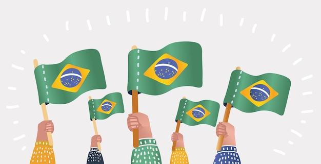 Hand der fans mit der flagge von brasilien