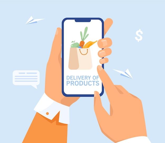 Hand des benutzers, der lieferung vom lebensmittelgeschäft bestellt. person, die lebensmittel im supermarkt online kauft