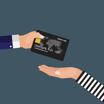 Hand des opfers dem räuber eine kreditkarte gebend.