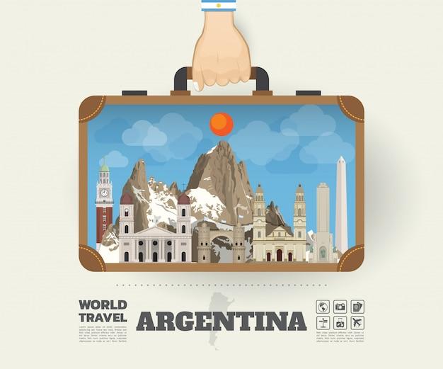 Hand, die argentinien-markstein-globale reise und reise infographic-tasche trägt
