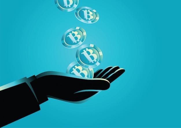 Hand, die bitcoins hält