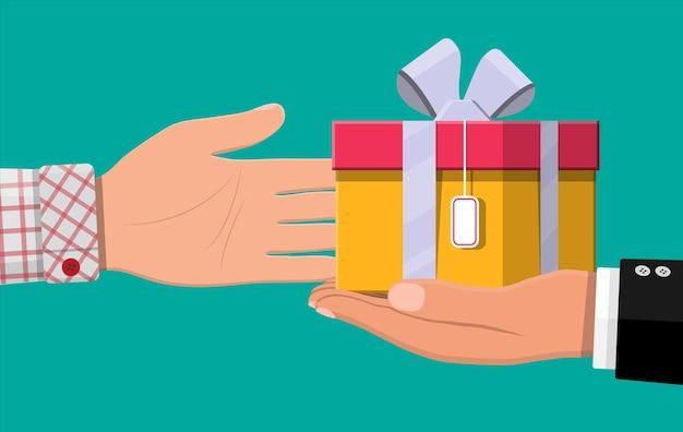Hand, die der anderen hand geschenkbox gibt. versteckte löhne, schwarze gehälter, steuerhinterziehung, bestechung. anti-korruptionskonzept. vektorillustration im flachen stil