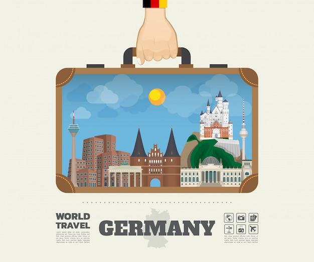 Hand, die deutschland-markstein-globale reise und reise infographic-tasche trägt.