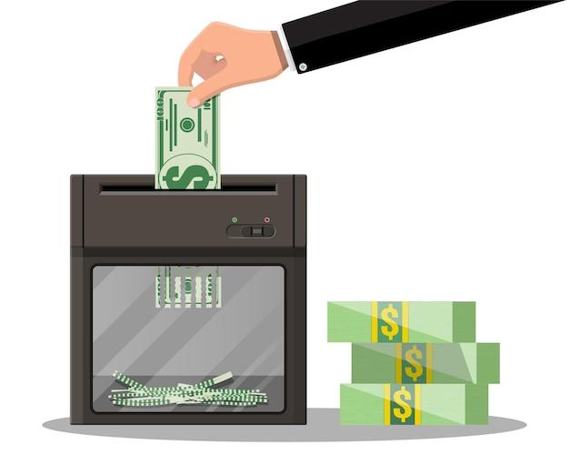 Hand, die dollarbanknote in schreddermaschine setzt. zerstörung kündigung geld schneiden. geld verlieren oder zu viel ausgeben.
