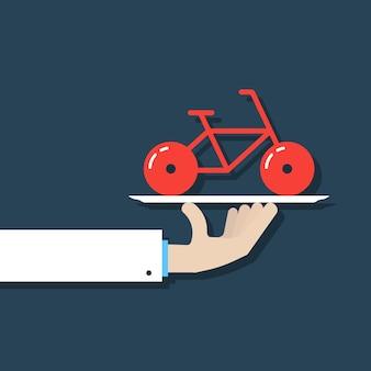 Hand, die fahrrad auf teller hält. konzept der fahrradvermietung, veloziped, radfahrer, reise, tour, gegenwart, reise. auf dunkelblauem hintergrund isoliert. flache moderne fahrrad-logo-design-vektor-illustration