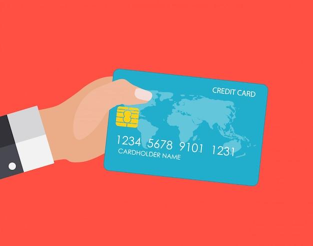 Hand, die kreditkarte hält. finanz- und online-zahlungsverkehr konzept