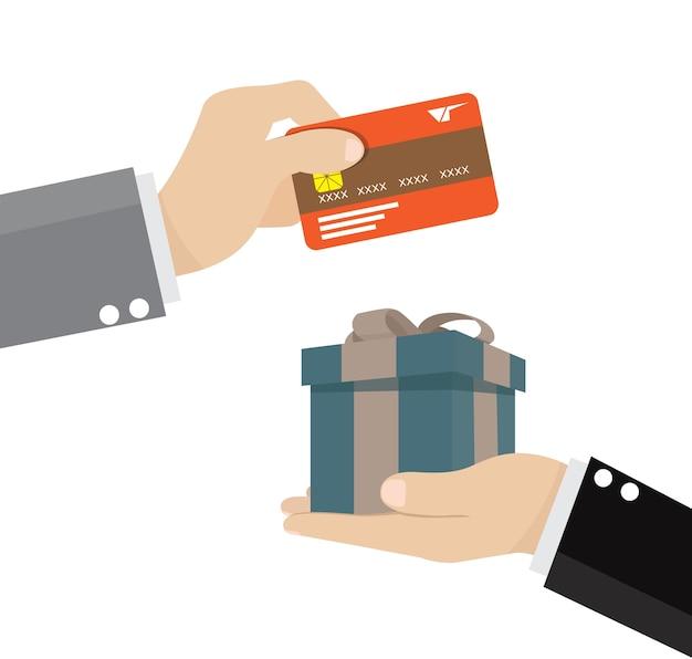 Hand, die kreditkarte und anwesendes geschenk stattdessen gibt.