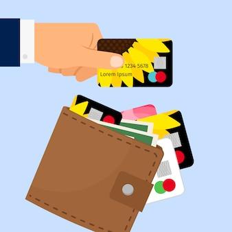 Hand, die kreditkarte von der geldbörse nimmt
