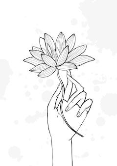 Hand, die lotusblume hält