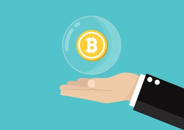 Hand, die luftblase bitcoins hält.