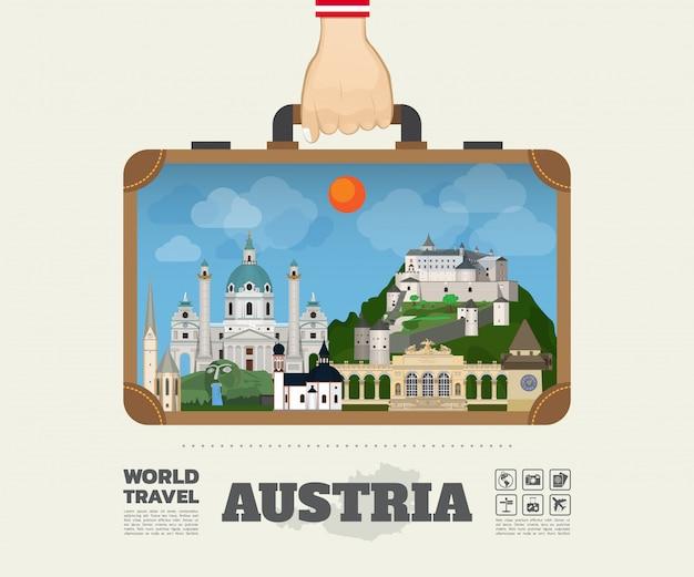 Hand, die österreich-markstein-globale reise und reise infographic-tasche trägt.