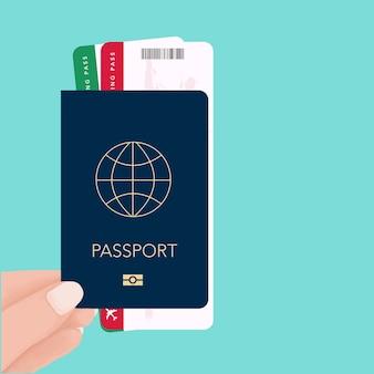Hand, die pass- und bordkartekarte hält