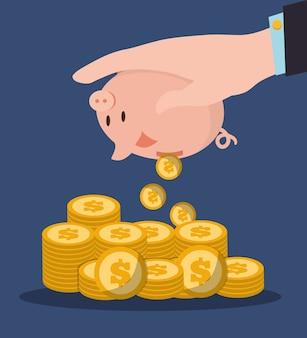 Hand, die piggy stapelmünzen hält