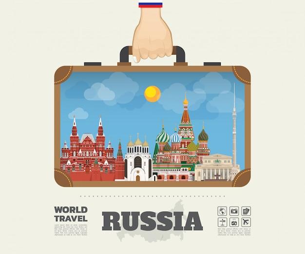 Hand, die russland-markstein-globale reise und reise infographic-tasche trägt. .