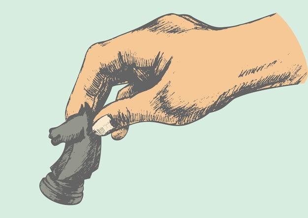 Hand, die schachritterstück hält