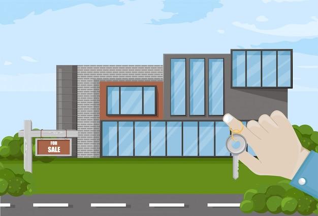 Hand, die schlüsselhaus für verkauf hält
