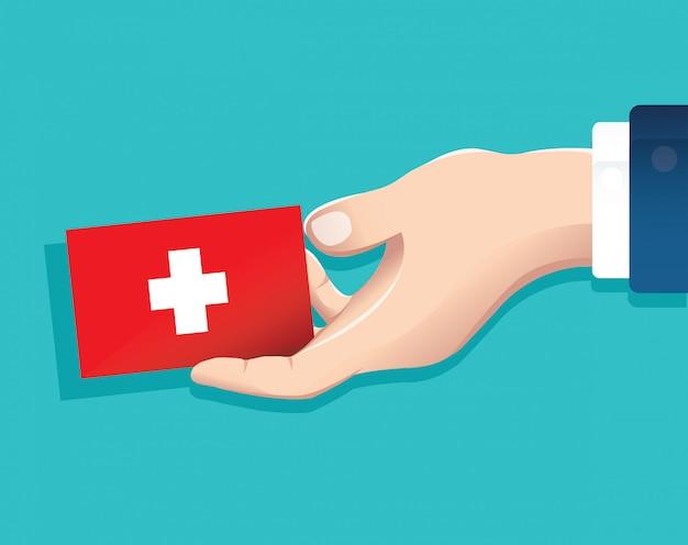 Hand, die schweiz-flaggenkarte