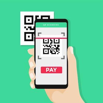 Hand, die smartphone hält, um qr-code zu scannen, um zu zahlen.
