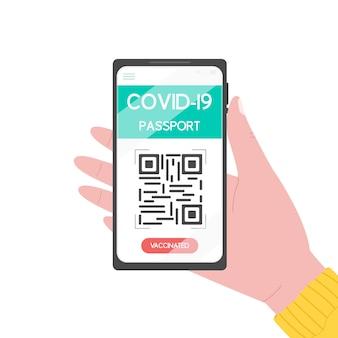 Hand, die smartphone mit elektronischem reisepass der covid19-impfung mit qr-code hält