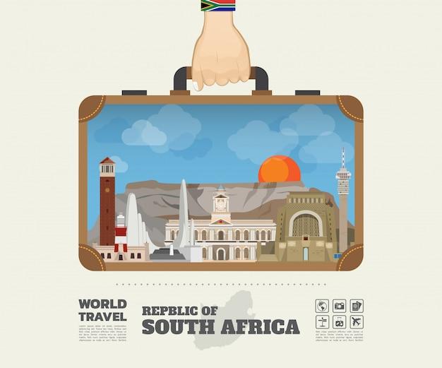 Hand, die südafrika-markstein-globale reise und reise infographic-tasche trägt.