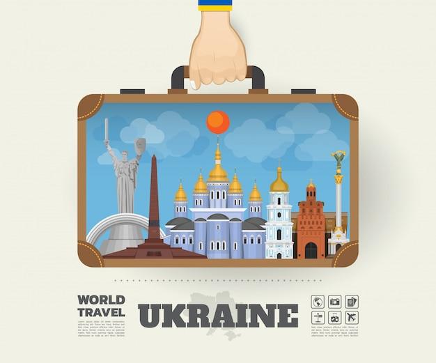 Hand, die ukraine-markstein-globale reise und reise infographic-tasche trägt.