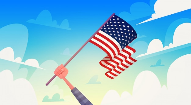 Hand, die usa-flagge über nationalem patriot-tag usa-feiertags-fahne des blauen himmels hält